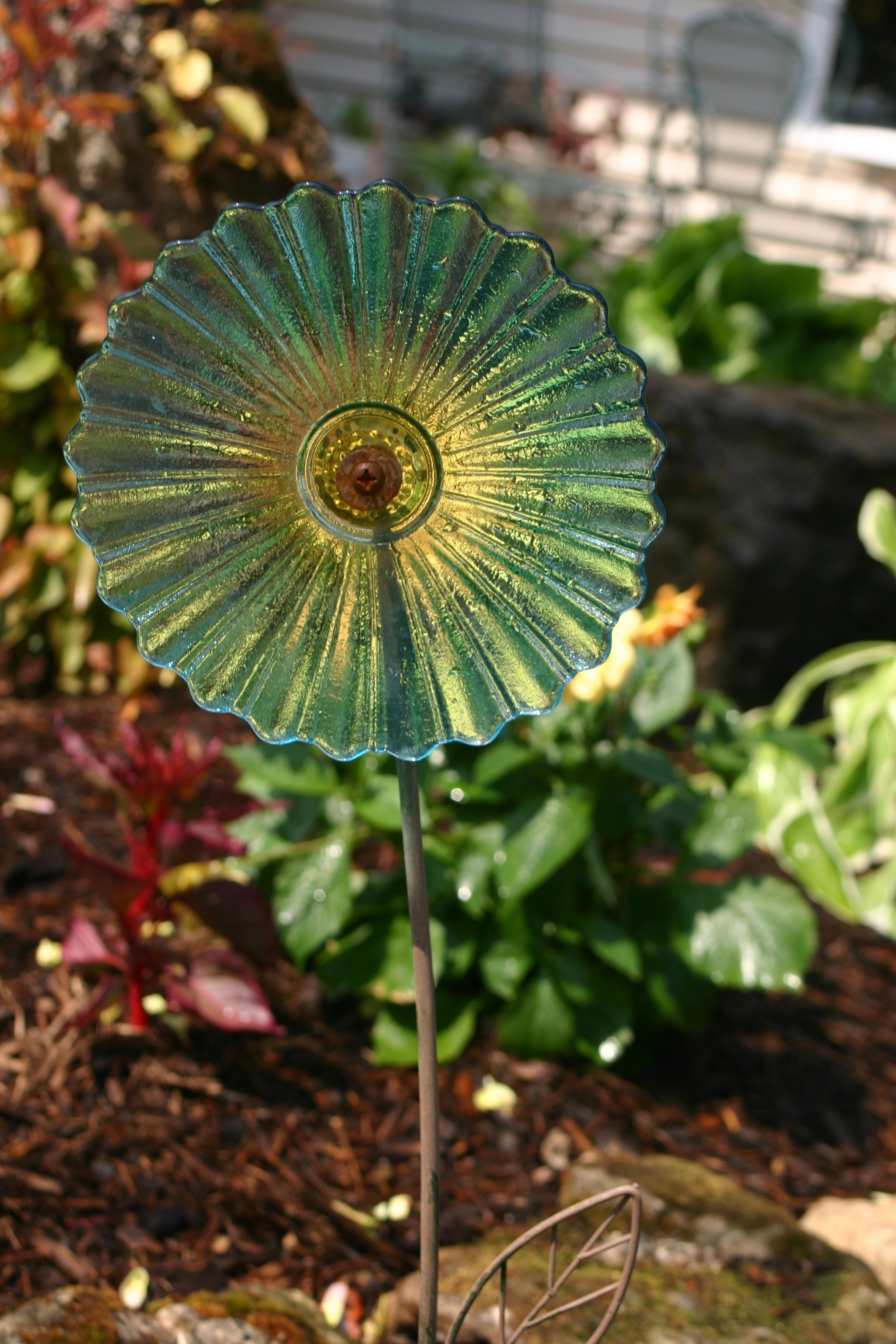 Recycled plate flowers weed it reap for Recycled glass flowers